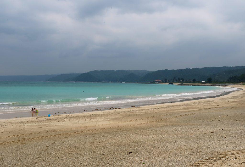 Okuma Beach blue water and empty beach