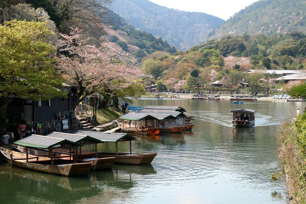 boats lining kyoto river